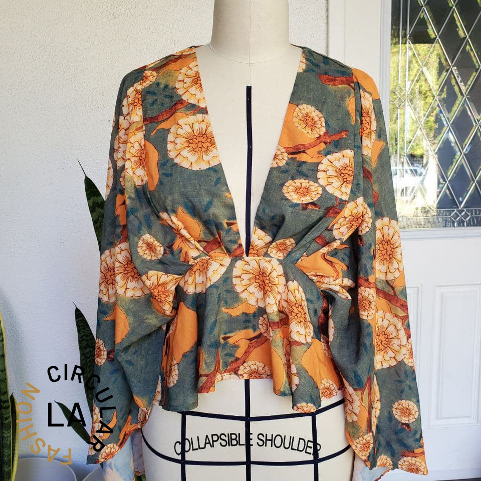 Flowy Green and Orange Floral Deep V-Neck Peplum Blouse