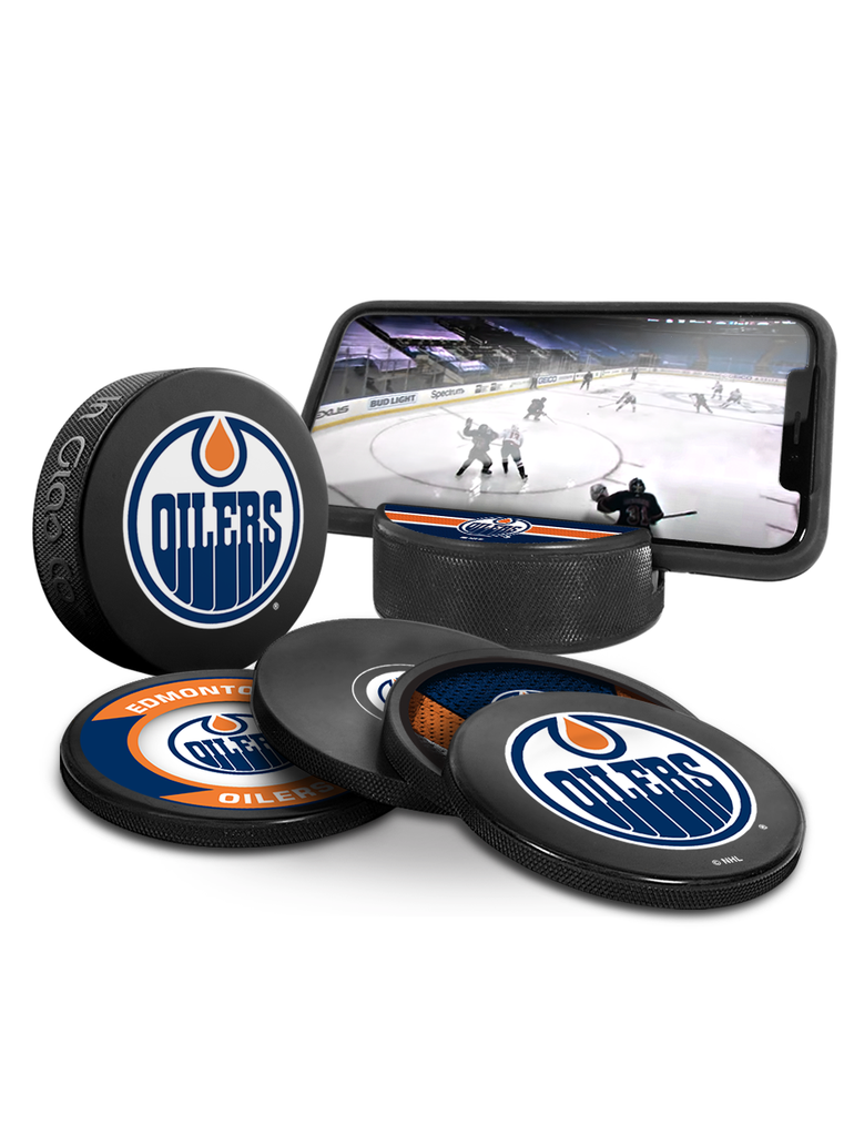NHL Edmonton Oilers Ultimate Fan 3-Pack. Includes: 1 NHL Official Classic Souvenir Hockey Puck / 4 Coasters / 1 Media Device Holder