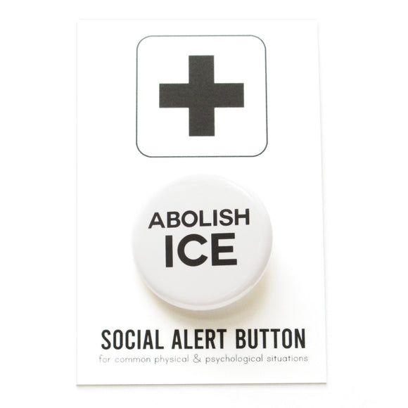 Round pinback button that says ABOLISH ICE. Black text on a white background. The button is pinned to a Social Alert Button backing card.