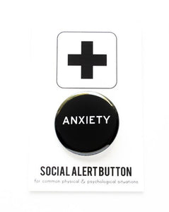 Round pinback button that says ANXIETY Black background with white text