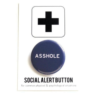 Round pinback button that says ASSHOLE. White text on a navy blue background