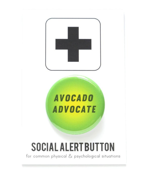 Round pinback button that says AVOCADO ADVOCATE. Dark green text on a light green gradient background