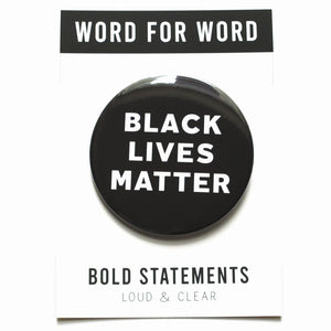 Three inch round pinback button that says BLACK LIVES MATTER. White text on a black background