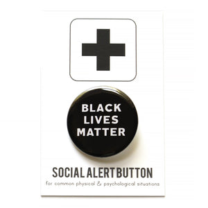 Round pinback button that says BLACK LIVES MATTER. White, text on a black background