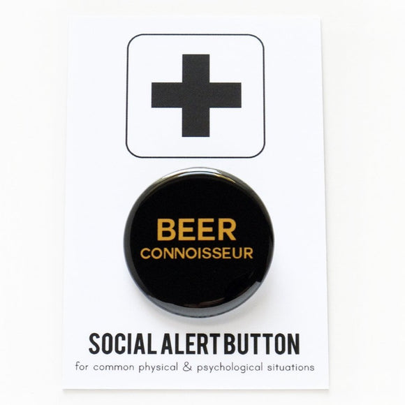 Round pinback button that says BEER CONNOISSEUR. Goldenrod text on a black background