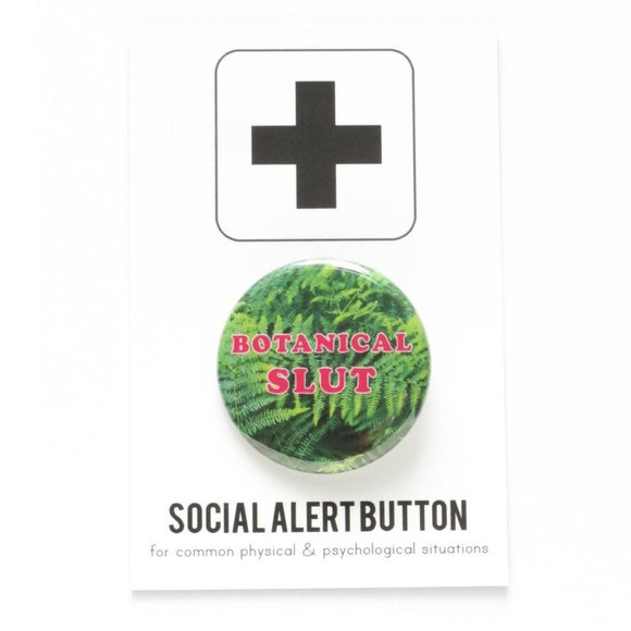Round pinback button that says BOTANICAL SLUT. Pink text on a fern photo background