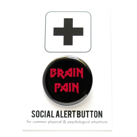 Round pinback button that says BRAIN PAIN. Red text on a black background.