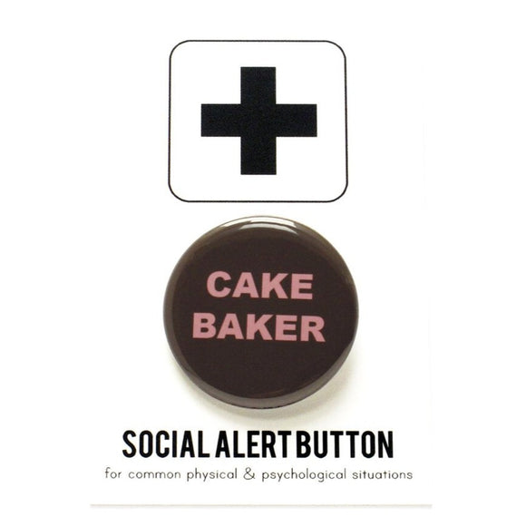 Round pinback button that says Cake Baker. Pink text on a brown background.