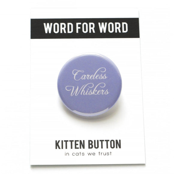 Round pinback button that says CARELESS WHISKERS. White text on a pale lavender background.
