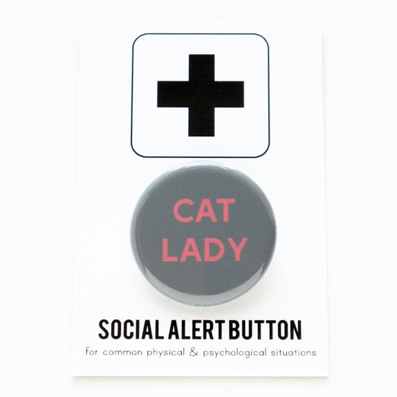 Round pinback button that says CAT LADY. Pink text on a gray background.