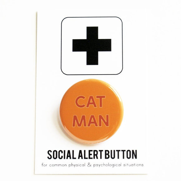 Round pinback button that says CAT MAN. Red-orange text on a orange background.
