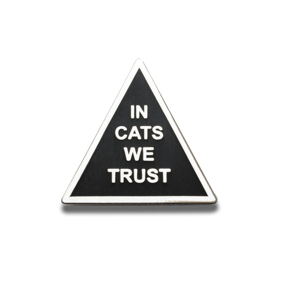 Triangle shaped hard enamel pin that says IN CATS WE TRUST.  Silver text and outline on a black enamel background.