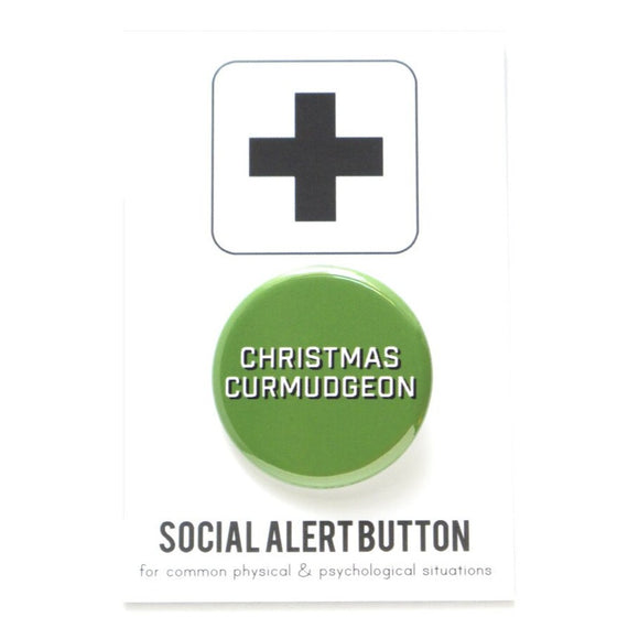 Round pinback button that says CHRISTMAS CURMUDGEON. White text with a black shadow on a green background.
