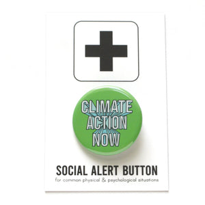 Round pinback button that says CLIMATE CHANGE NOW. White text on a kelly green background.