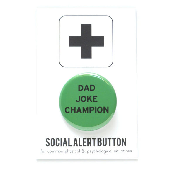 Round pinback button that says DAD JOKE CHAMP. Black text on a green background.
