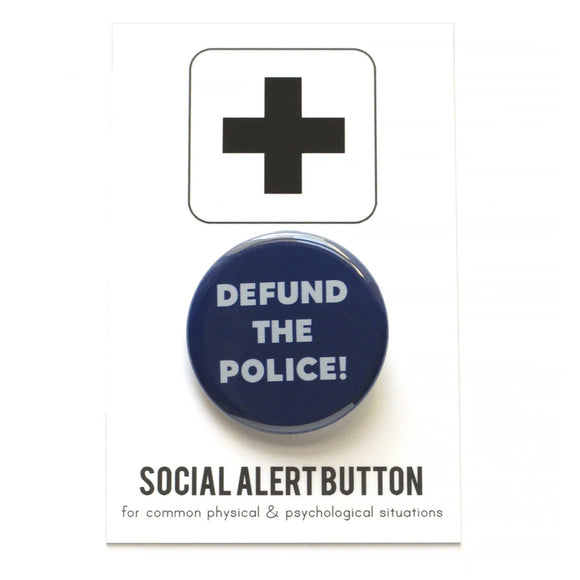 Round pinback button that says DEFUND THE POLICE. Light gray text on a navy blue background.