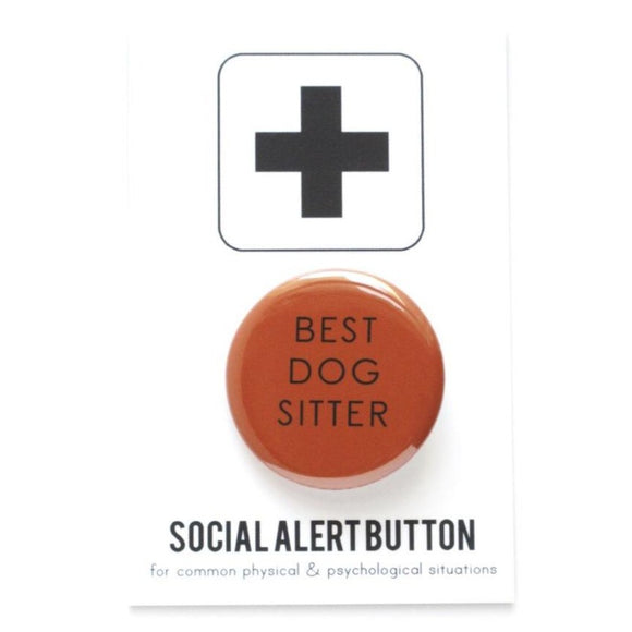 Round pinback button that says BEST DOG SITTER. Black text on an auburn  background