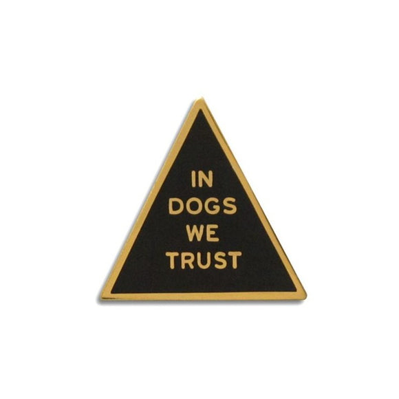 Triangle shaped hard enamel pin that says IN DOGS WE TRUST.  Gold text and outline on a black enamel background.