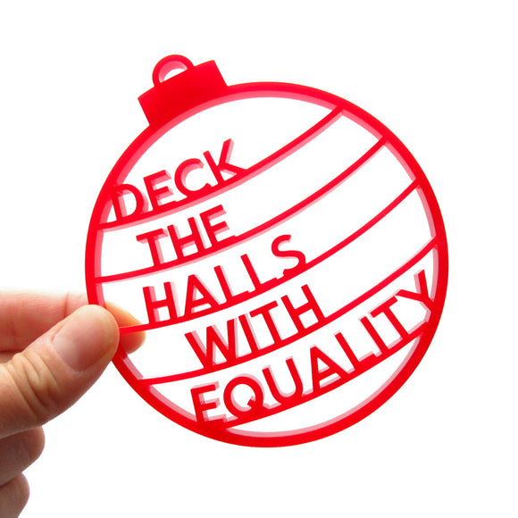 Laser cut red acrylic holiday ornament that says DECK THE HALLS WITH EQUALITY