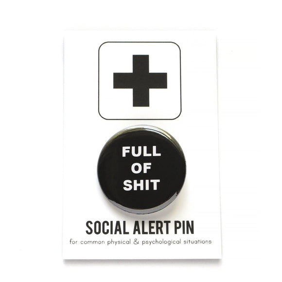 Round pinback button that says FULL OF SHIT. White text on a black background.