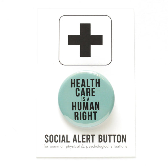 Round pinback button that says HEALTHCARE IS A HUMAN RIGHT.  Black text on a hospital blue-green background.