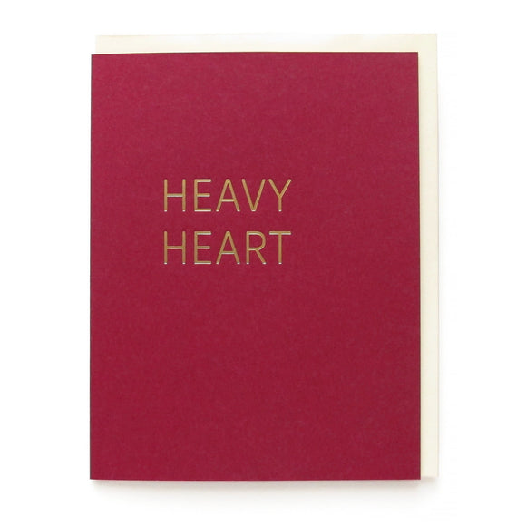 Burgandy greeting card that says HEAVY HEART in gold hot foil pressed text.