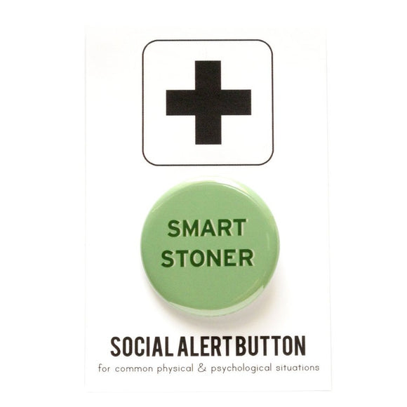 Round pinback button that says SMART STONER.  Dark green text on a light green background.  Button is pinned to a social alert button backing card.