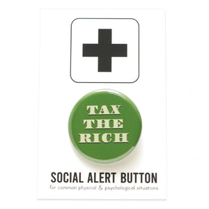 Round pinback button that says TAX THE RICH.  The text is a light green, on a money green background.  The button is on a Social Alert Button backing card.