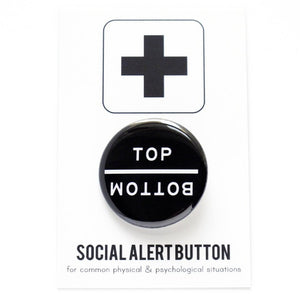 Round pinback button that says TOP and directly underneath it, upside down, its says BOTTOM.  White text on a black background.  The button is pinned to a Social Alert Button backing card.