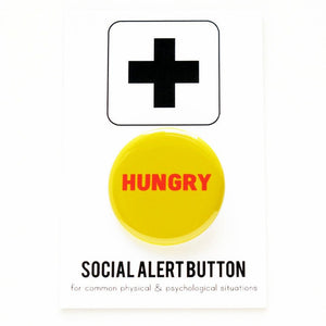 Round pinback button that says HUNGRY.  Red text on a yellow background.  The button is pinned to a Social Alert Button card.