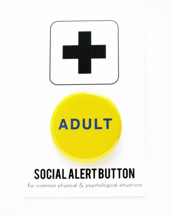 Round pinback button that says ADULT. Blue text on a yellow background.  The button is pinned to a Social Alert Button backing card.