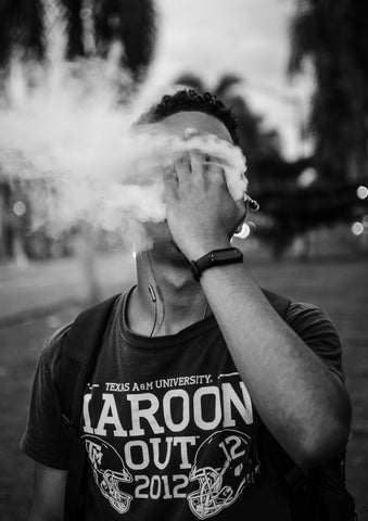 guy with hand on face while vaping