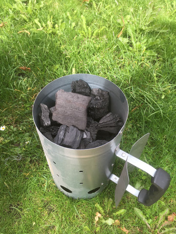Filling the smoker with charcoal