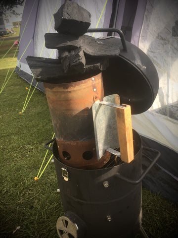 Charcoal stacked high on the chimney starter