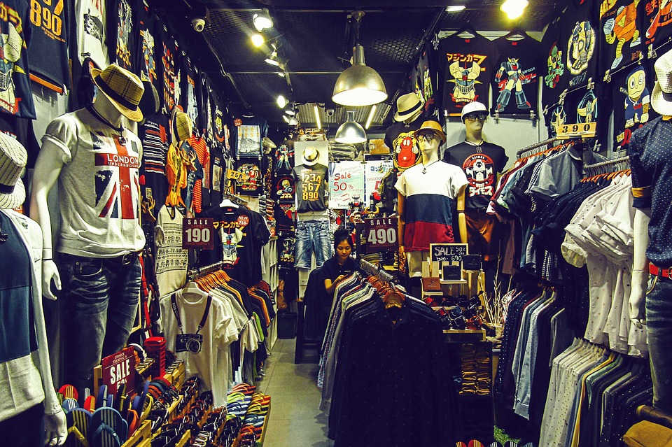 A variety of t-shirts, hats, and other apparel