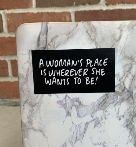 A WOMAN'S PLACE Sticker-0