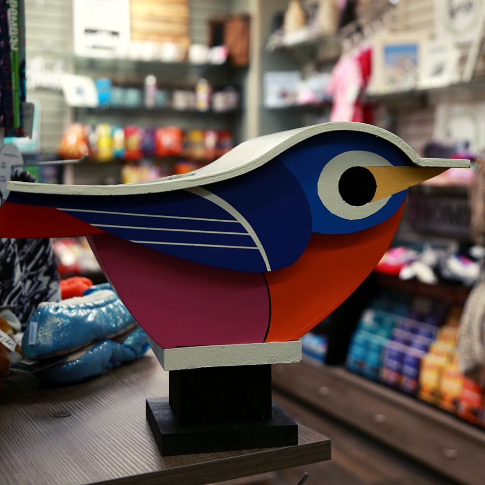 Handmade JR's Birdhouse. This colourful birdhouse is shaped as a small bird that is in a perching stance.