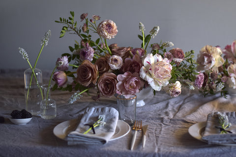 Tablescape with floral centerpieces and dinner places set. Flowers and design by Ingrid Carozzi of Tin Can Studios.