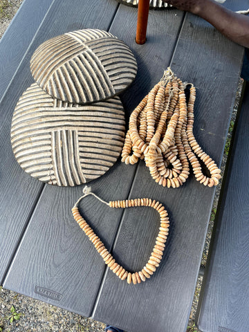 African stone beads in necklace and two small round, Bamileke shields