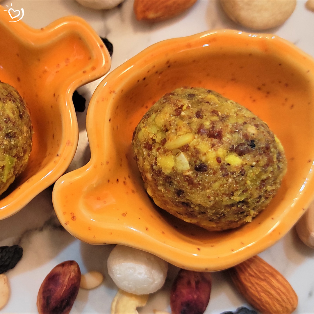 2) Ladoo Damdaar x 4 units ​  Strengthening ladoo​  Has 22 ingredients from Amaranth to Sprouted moong flour to Gond & a whole lotta love! ​  Now this is a loaded ladoo!