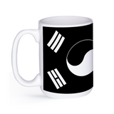 graphic image of a black and white flag of South Korea on a coffee mug  presented by Star Showroom