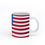 graphic image of the flag of the United States on a coffee mug  presented by Star Showroom