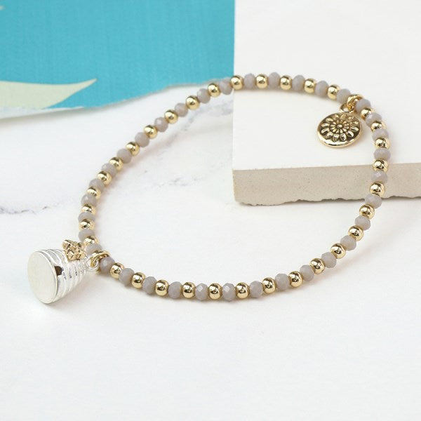 POM Grey bead bracelet with a silver and gold beehive charm