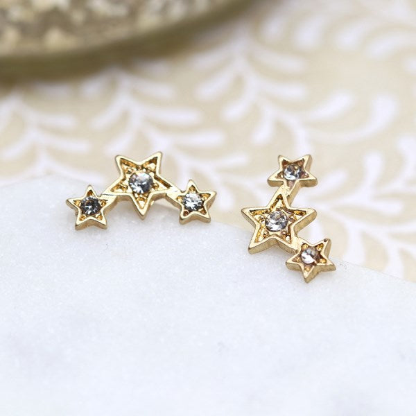 POM Gold plated triple star earrings with crystals and a worn finish