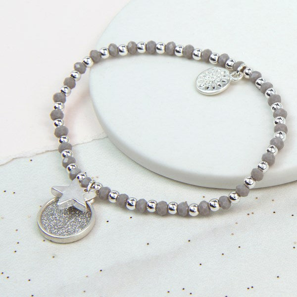 POM Silver plated sparkle disc and star bracelet with grey beads