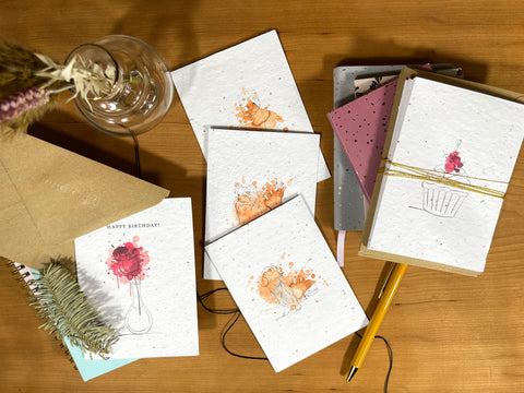 An image of colourful seed cards, made from recycled post consumer waste.