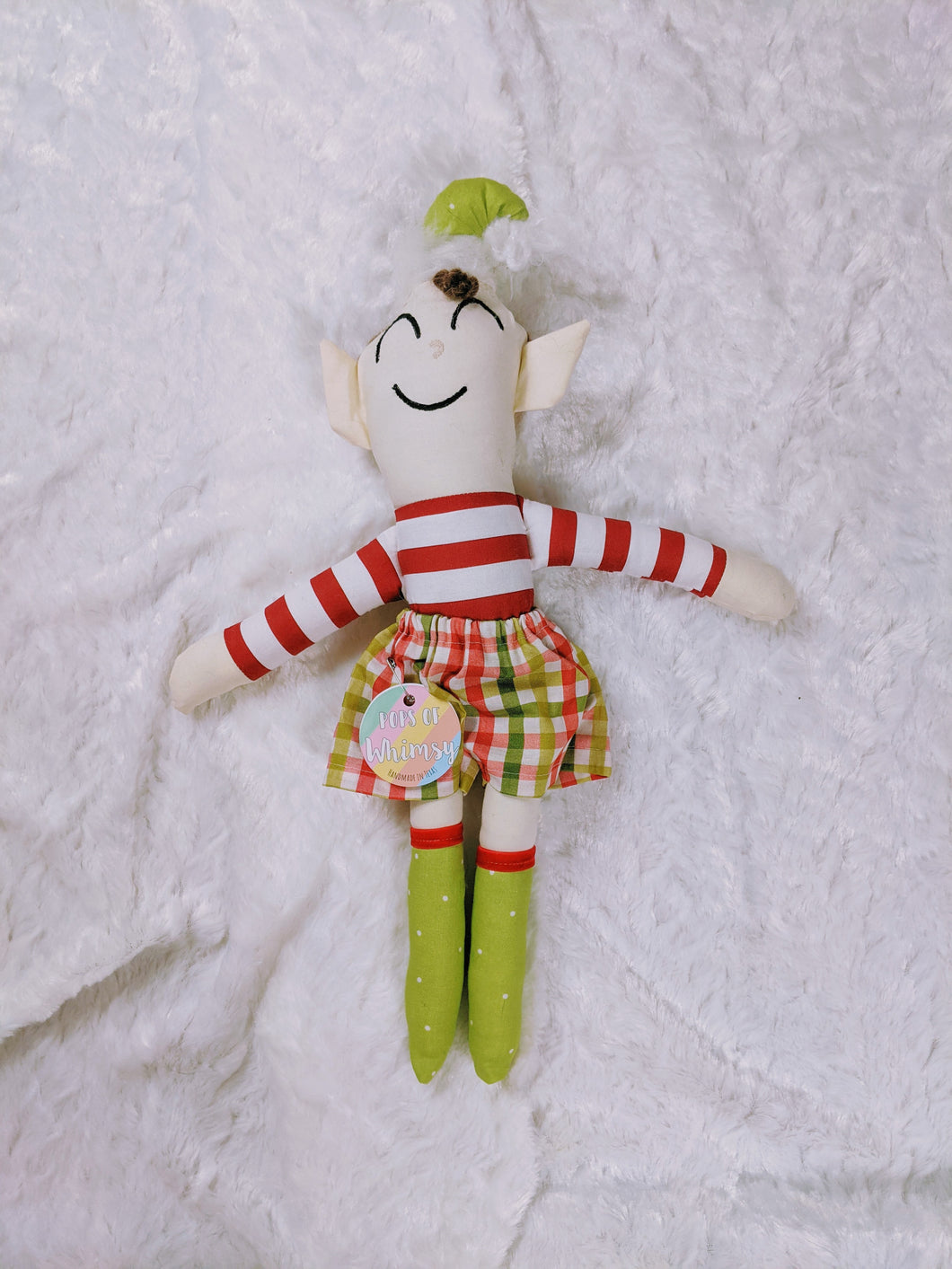 happy the elf doll
