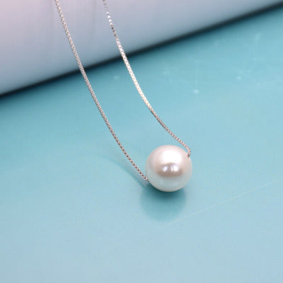 Pearl necklace hanging