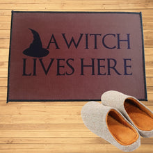 Load image into Gallery viewer, A Witch Lives Here Indoor / Outdoor Doormat