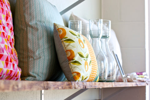 Organic pillows and glass carafes available at the Monaluna store in Walnut Creek
